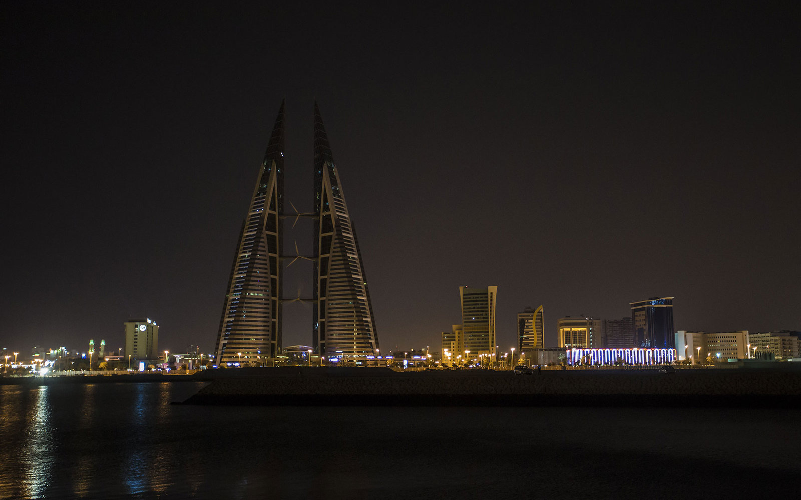 MANAMA, BAHRAIN - MARCH 19: Bahrain World Trade Center is seen after its lights were turned off during the Earth Hour event organized by the World Wide Fund for Nature (WWF) to draw attention to global climate change on March 19, 2016 in Manama, Bahrain.