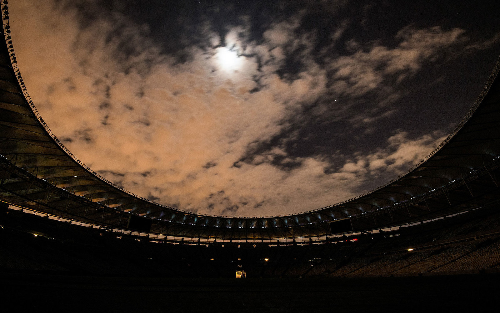 RIO DE JANEIRO, BRAZIL - MARCH 19:  The Maracana Stadium is seen with its lights off during the 2016 Earth Hour event on March 19, 2016 in Rio de Janeiro, Brazil. The Maracana Stadium will host the Opening and Closing Ceremonies for the Rio 2016 Olympic G