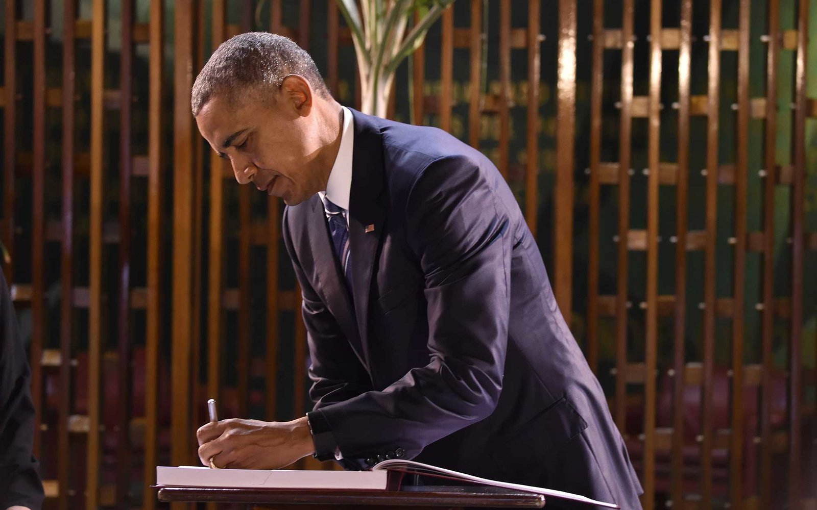 US President Barack Obama signs a visitors' book at the Revolution Palace in Havana on March 21, 2016. US President Barack Obama and his Cuban counterpart Raul Castro met Monday in Havana's Palace of the Revolution for groundbreaking talks on ending the s