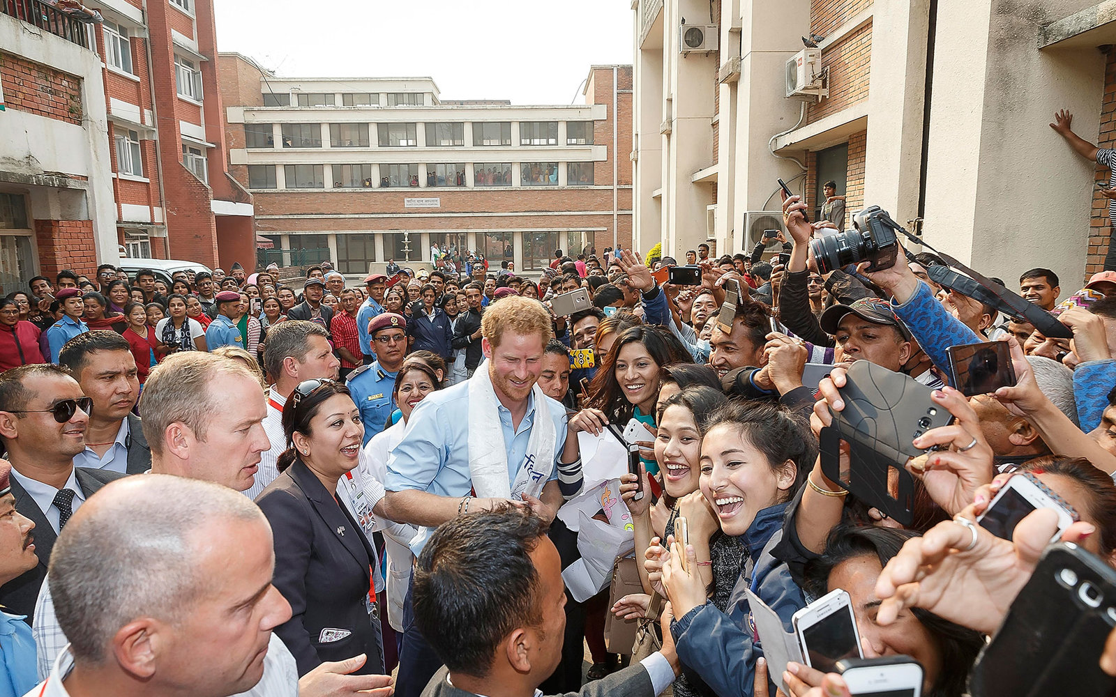 POKHARA, NEPAL - MARCH 23:  Prince Harry is greated by crowds as he visits Kanti Children's Hospital to meet young people being treated with burns on March 23, 2016 in Pokhara, Nepal.  (Photo by Danny Martindale/WireImage)