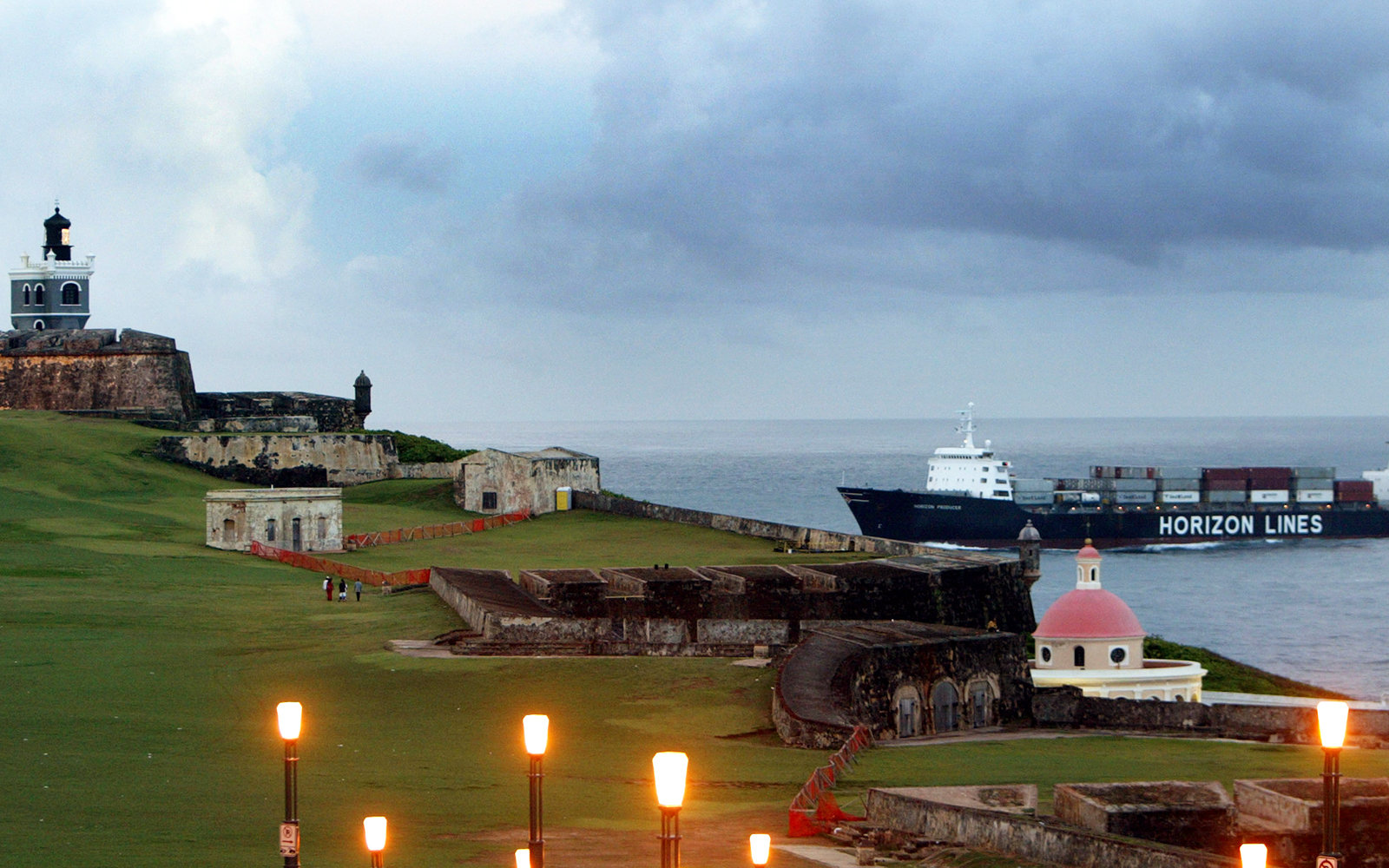 SAN JUAN, PUERTO RICO- APRIL 26: A ship comes into port past the Castillo de San Felipe del Morro April 26, 2004 in Old San Juan, the original capital city of San Juan, Puerto Rico. Begun in the early 16th century, El Morro was the city's primary protecti