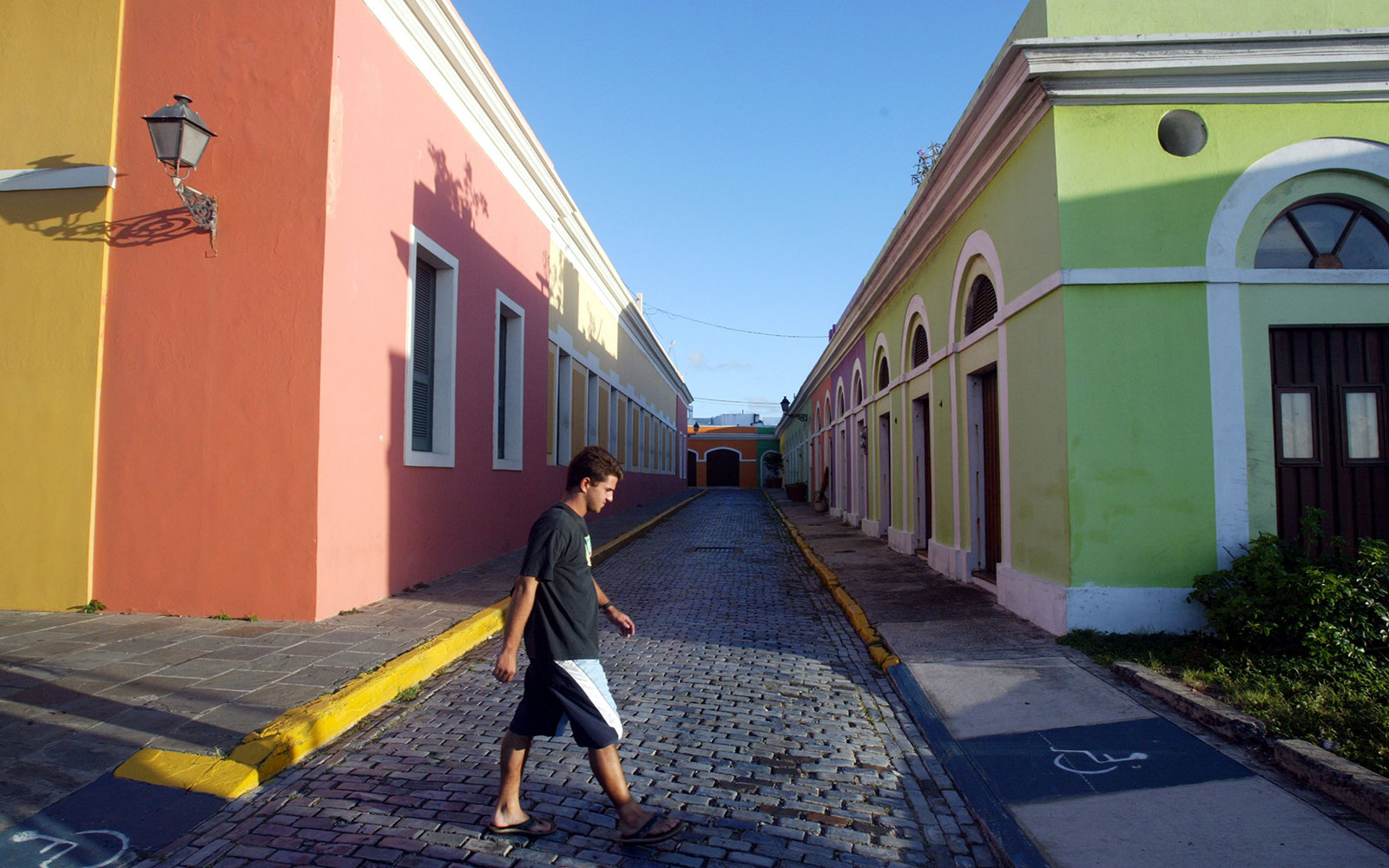SAN JUAN, PUERTO RICO- APRIL 25: Colorful homes line the cobblestoned streets April 25, 2004 in Old San Juan, the original capital city of San Juan, Puerto Rico. The old city is a historic district of seven square blocks made up of ancient buildings and c