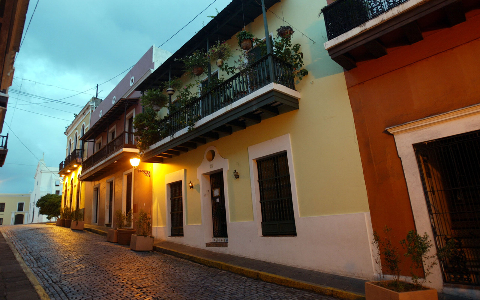 SAN JUAN, PUERTO RICO- APRIL 26: Colorful homes line the cobblestoned streets April 26, 2004 in Old San Juan, the original capital city of San Juan, Puerto Rico. The old city is a historic district of seven square blocks made up of ancient buildings and c