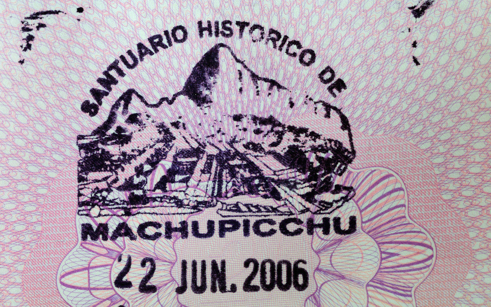 C64RM8 Machu Picchu Souvenir Passport Stamp in a United Kingdom Passport