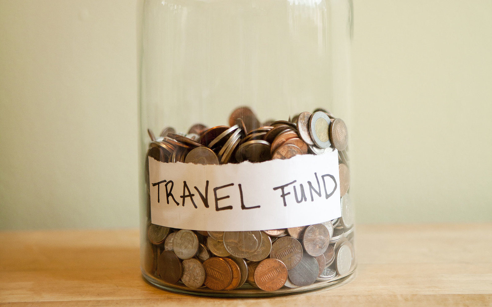 Coins in 'travel fund' jar