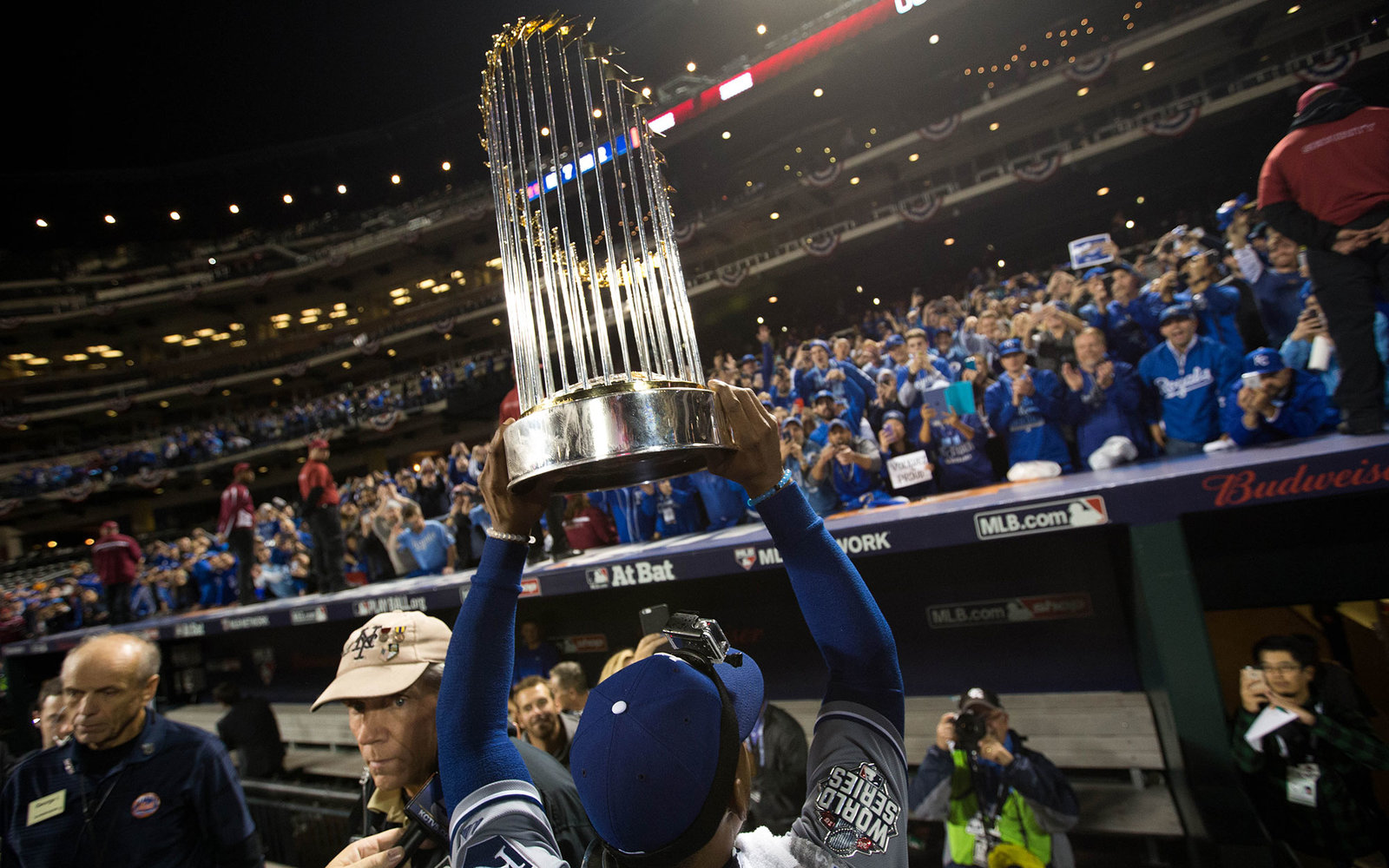 NEW YORK, NY - NOVEMBER 1:  Jarrod Dyson #1 of the Kansas City Royals is seen on the field with the Commissioner's Trophy after defeating the New York Mets in Game 5 of the 2015 World Series at Citi Field on Sunday, November 1, 2015 in the Queens borough