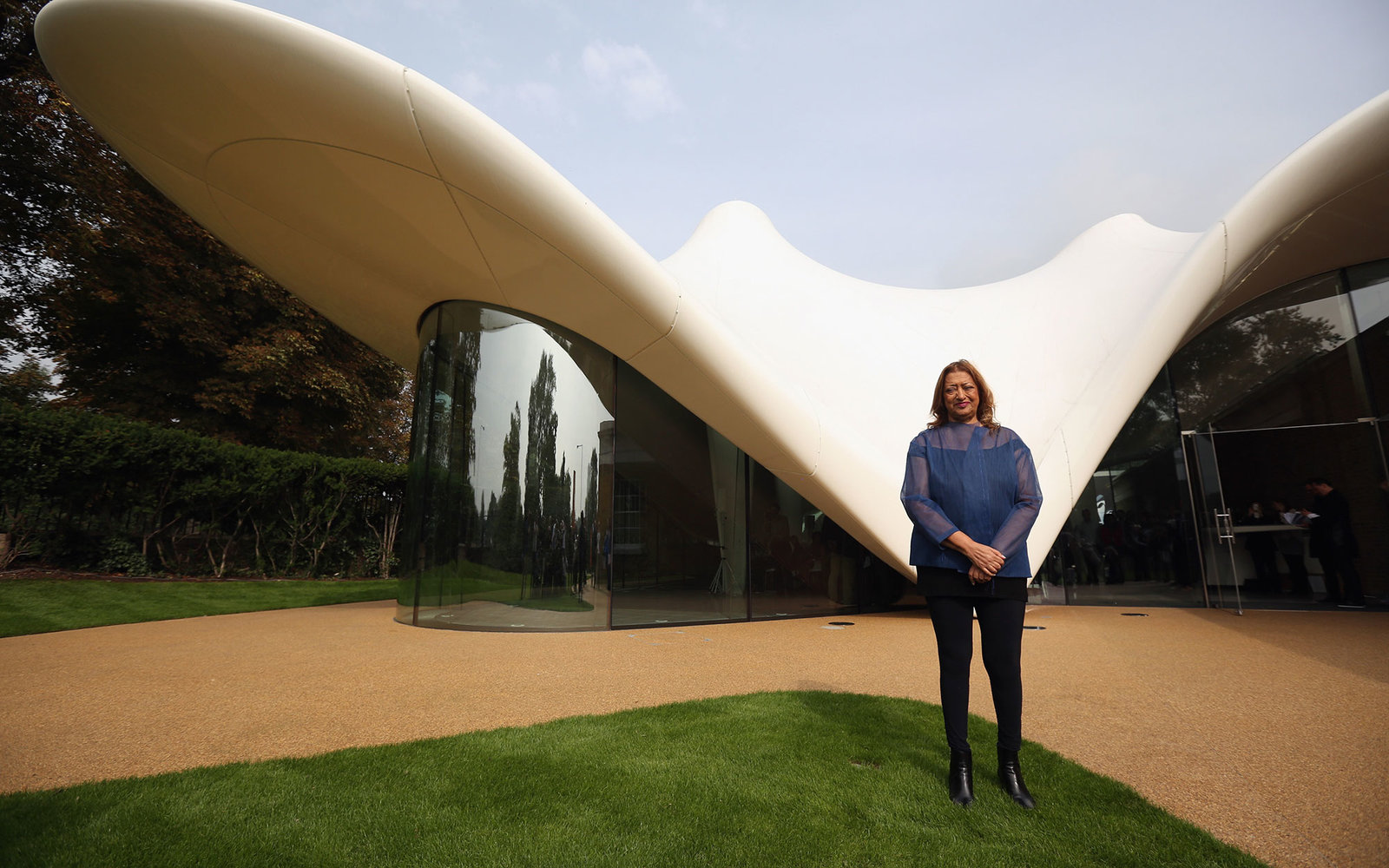 LONDON, ENGLAND - SEPTEMBER 25:  Architect Zaha Hadid poses for a photograph in front of the redeveloped Serpentine Sackler Gallery in Hyde Park on September 25 2013 in London, England. The renovation of the 1805 gunpowder store, located on the north side
