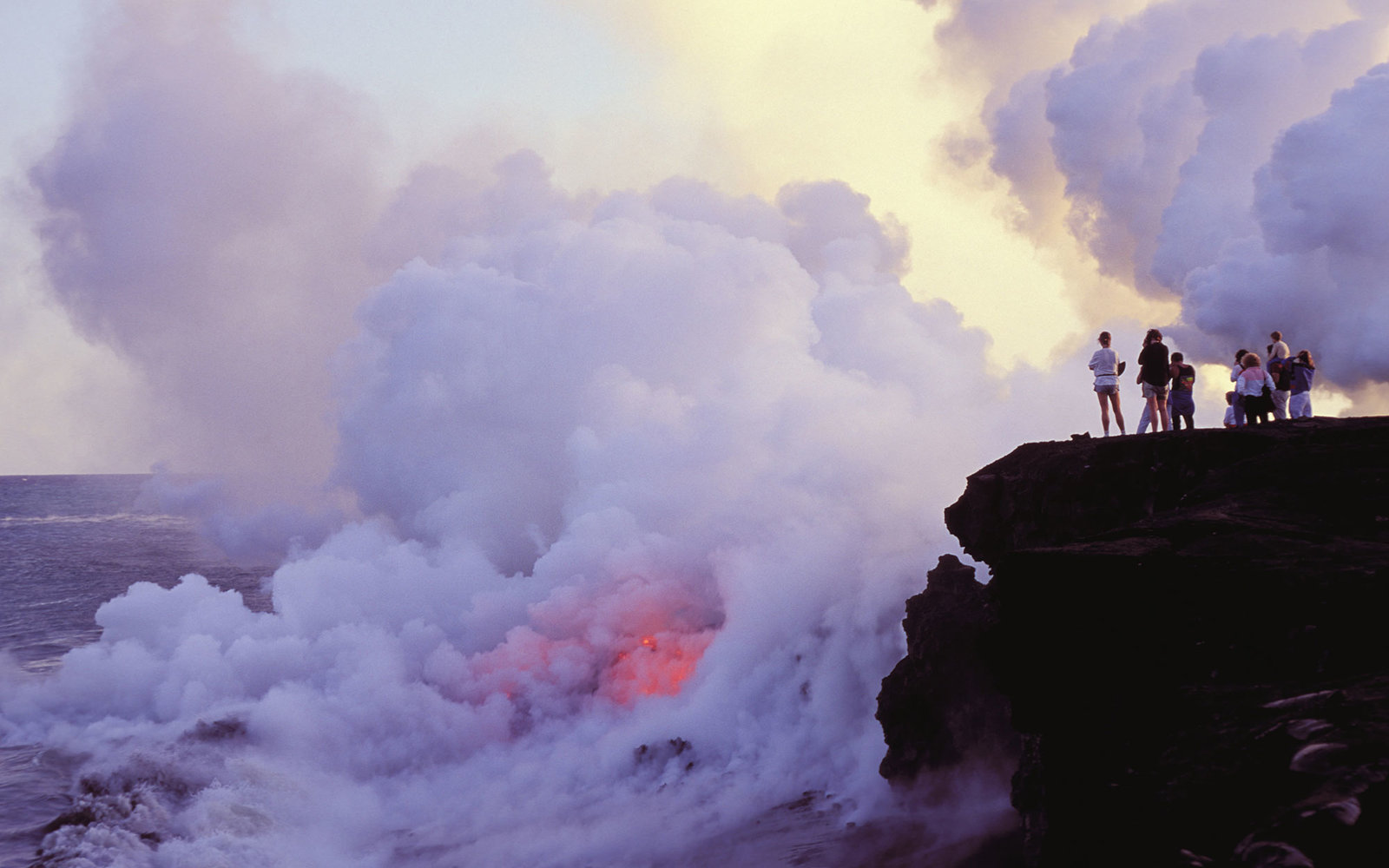Hawaii, Big Island, Wahaula, People watching lava flow into ocean