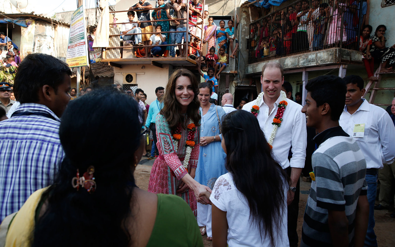 MUMBAI, INDIA - APRIL 10:   Prince William, Duke of Cambridge and Catherine, Duchess of Cambridge during a visit to the Banganga Water tank, where they met representatives of SMILE during the royal visit to India and Bhutan on April 10, 2016 in Mumbai, In