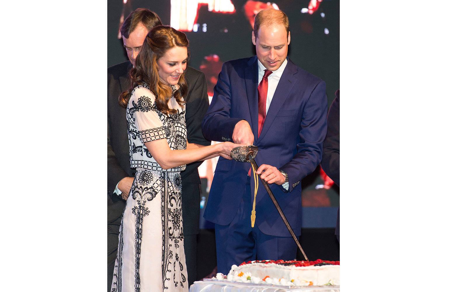 NEW DELHI, INDIA - APRIL 11:  Prince William, Duke of Cambridge and Catherine, Duchess of Cambridge cut a birthday cake for Queen Elizabeth II at a Garden party celebrating the Queen's 90th birthday on April 11, 2016 in New Delhi, India.  (Photo by Mark C