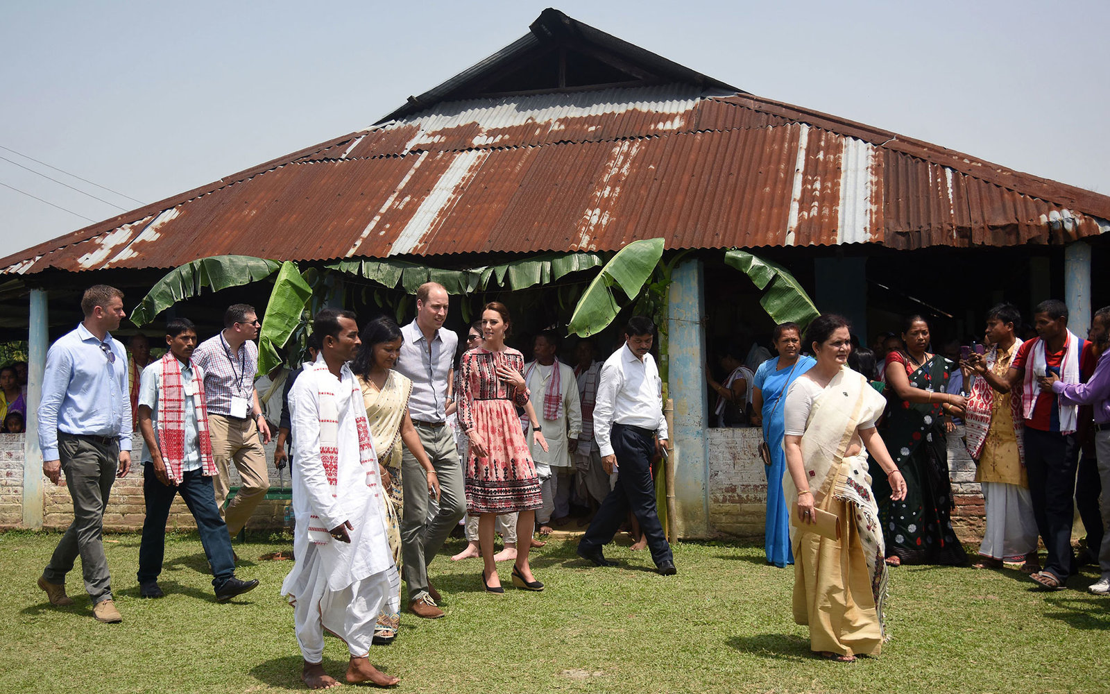 Britain's Prince William (centre L), Duke of Cambridge, and Catherine (centre R), Duchess of Cambridge, emerge after visiting a 'Namghar', an Assamese site of congregational worship in Panbari village, in Kaziranga, some 250 km from Guwahati, the capital
