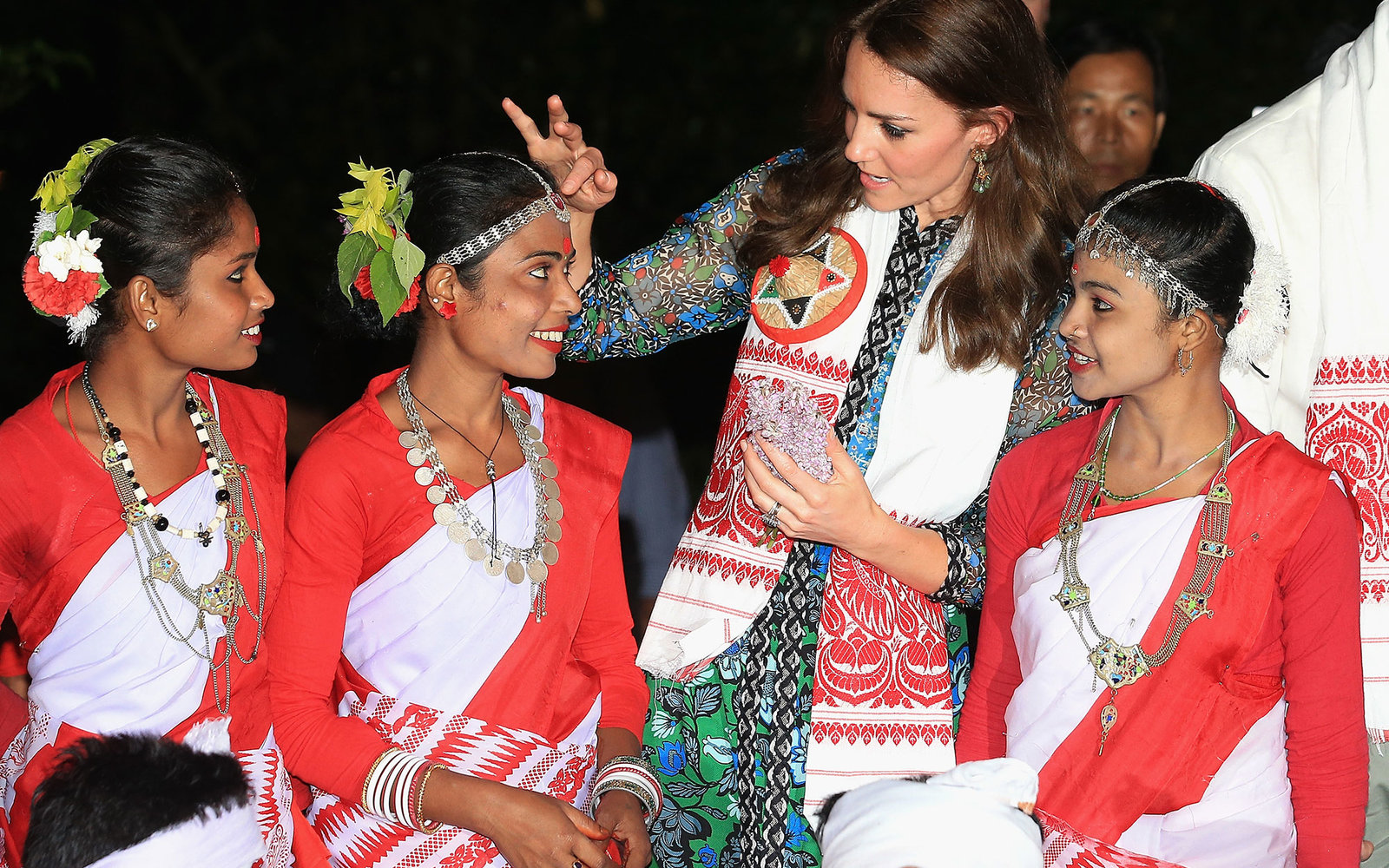 KAZIRANGA, INDIA - APRIL 12:  Catherine, Duchess of Cambridge with dancers by the fireside during a Bihu Festival Celebration at Diphlu River Lodge on day 3 of the royal visit to India and Bhutan on April 12, 2016 in Kaziranga, India. The Duke and Duchess