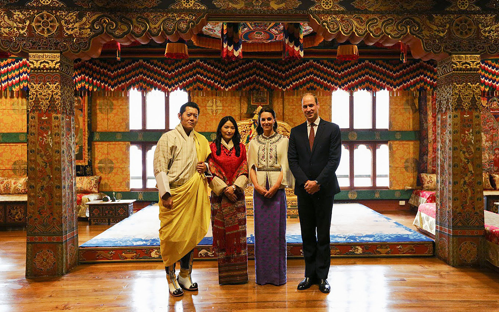CORRECTION - In this handout photograph released by the Royal Office for Media Bhutan on April 14, 2016, Britain's Prince William (R), Duke of Cambridge, and his wife Catherine (2nd R), Duchess of Cambridge, pose with Bhutan's King Jigme Khesar Namgyel Wa