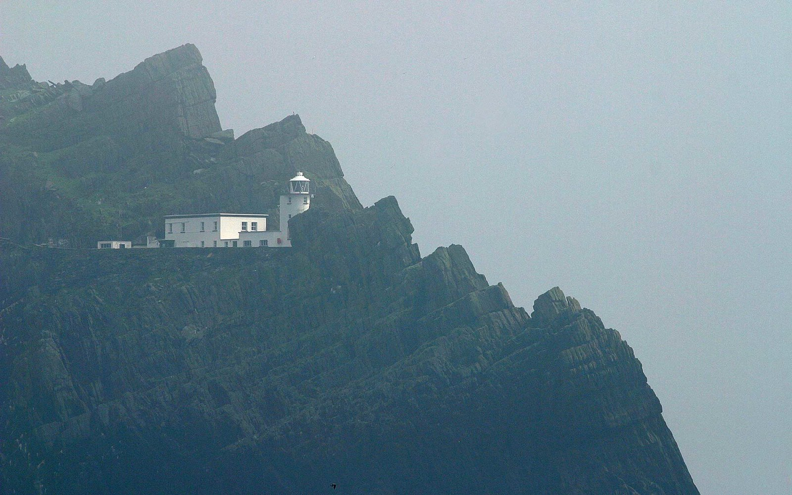 The lighthouse of Skellig Michael nestles among the highest rocks.