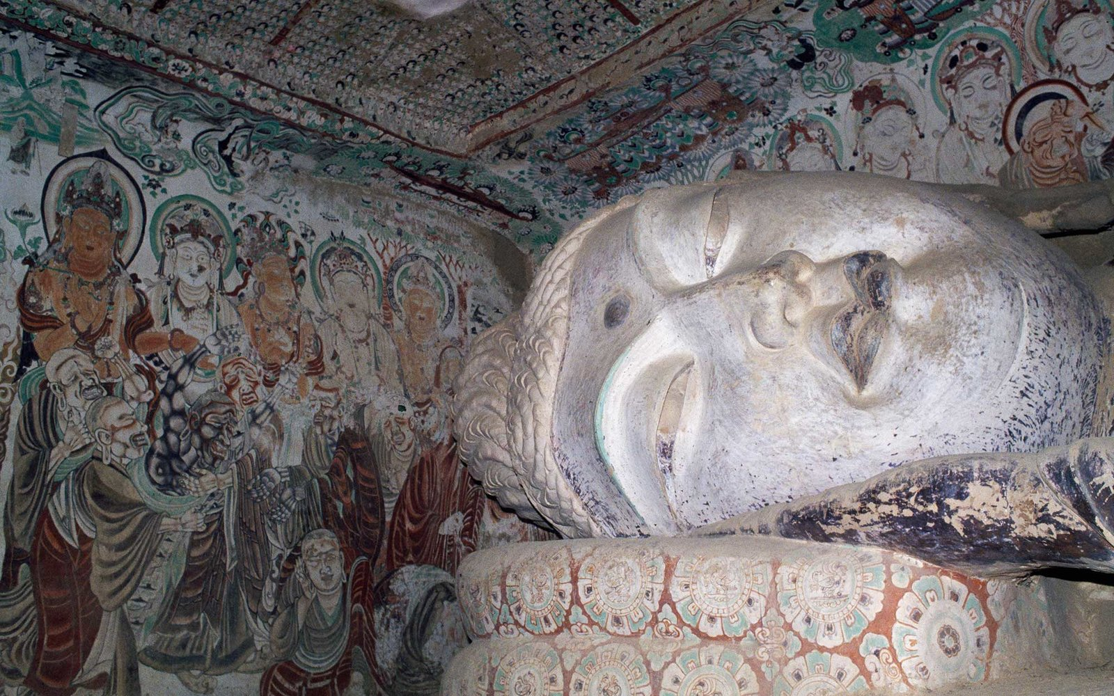 CHINA - DECEMBER 10: Sleeping Buddha, face detail, Mogao Caves, Dunhuang, Gansu Province, China. (Photo by DeAgostini/Getty Images)