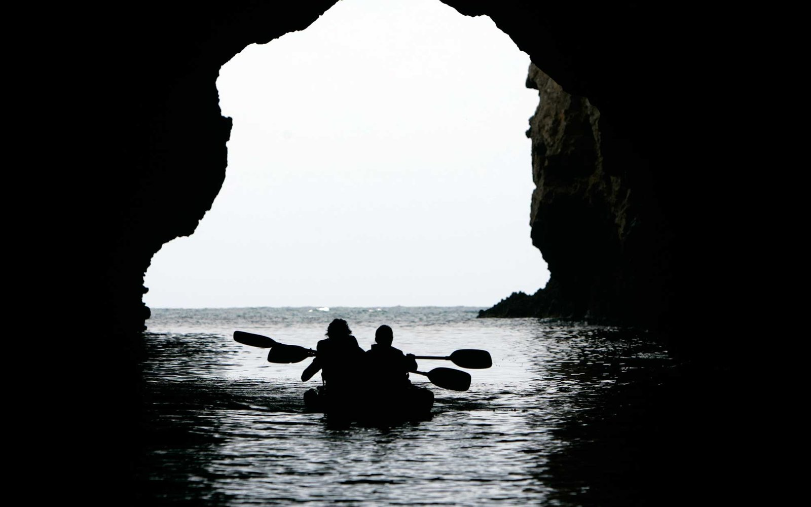 A couple with the Channel Islands Whale Expedition group kayak through Painted Cave at Santa Cruz Island, Channel Islands National Park. The tour was presented by the Aquarium of the Pacific, Channel Islands National Marine Sanctuary, Channel Islands Nati