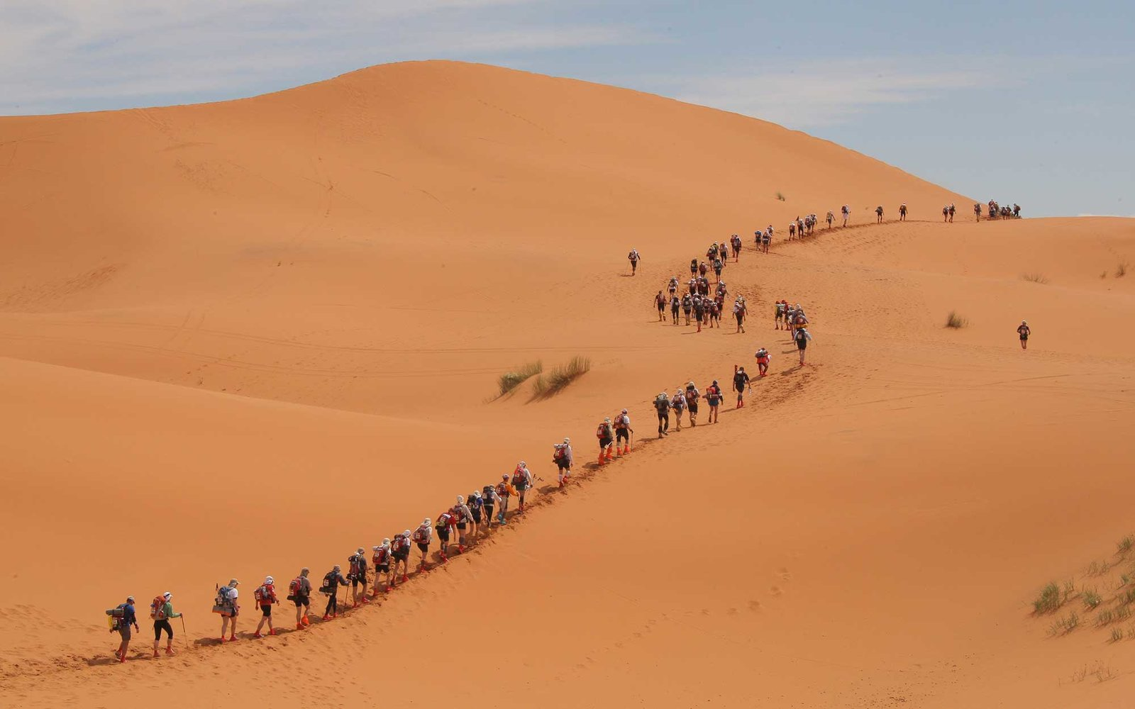A long file of competitors take the start of the 24th Marathon des Sables in the Sahara desert, on March 30, 2009 climbing the first dunes of Merzouga, some 300 kilometres south of Ouarzazate in Morocco, a day late due to heavy rain last week. The first s