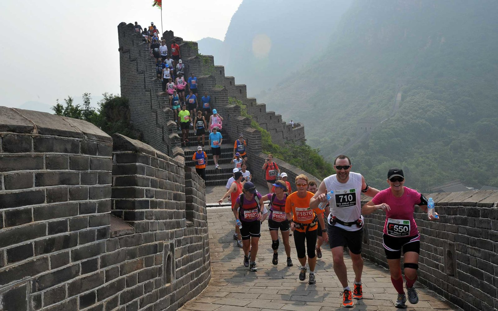 Runners compete in the Great Wall marathon at Huangyaguan (Yellow Cliff Pass) Great Wall of China in Tianjin on May 19, 2012.  The annual race attracts more than 1,600 athletes from 49 countries and is regarded as one of the most challenging marathons in