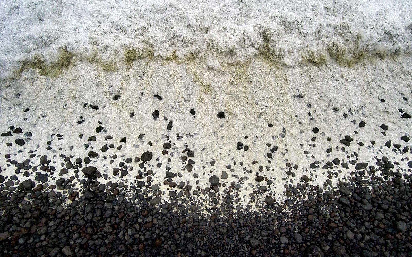 Waves breaking on black sand beach, Iceland