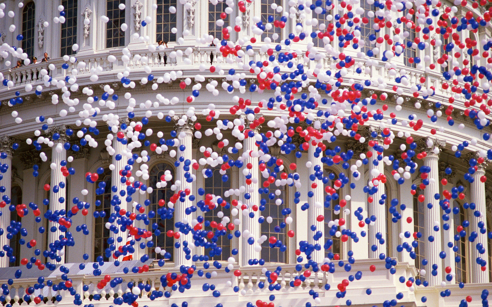 Capitol Building with red, white, and blue balloons