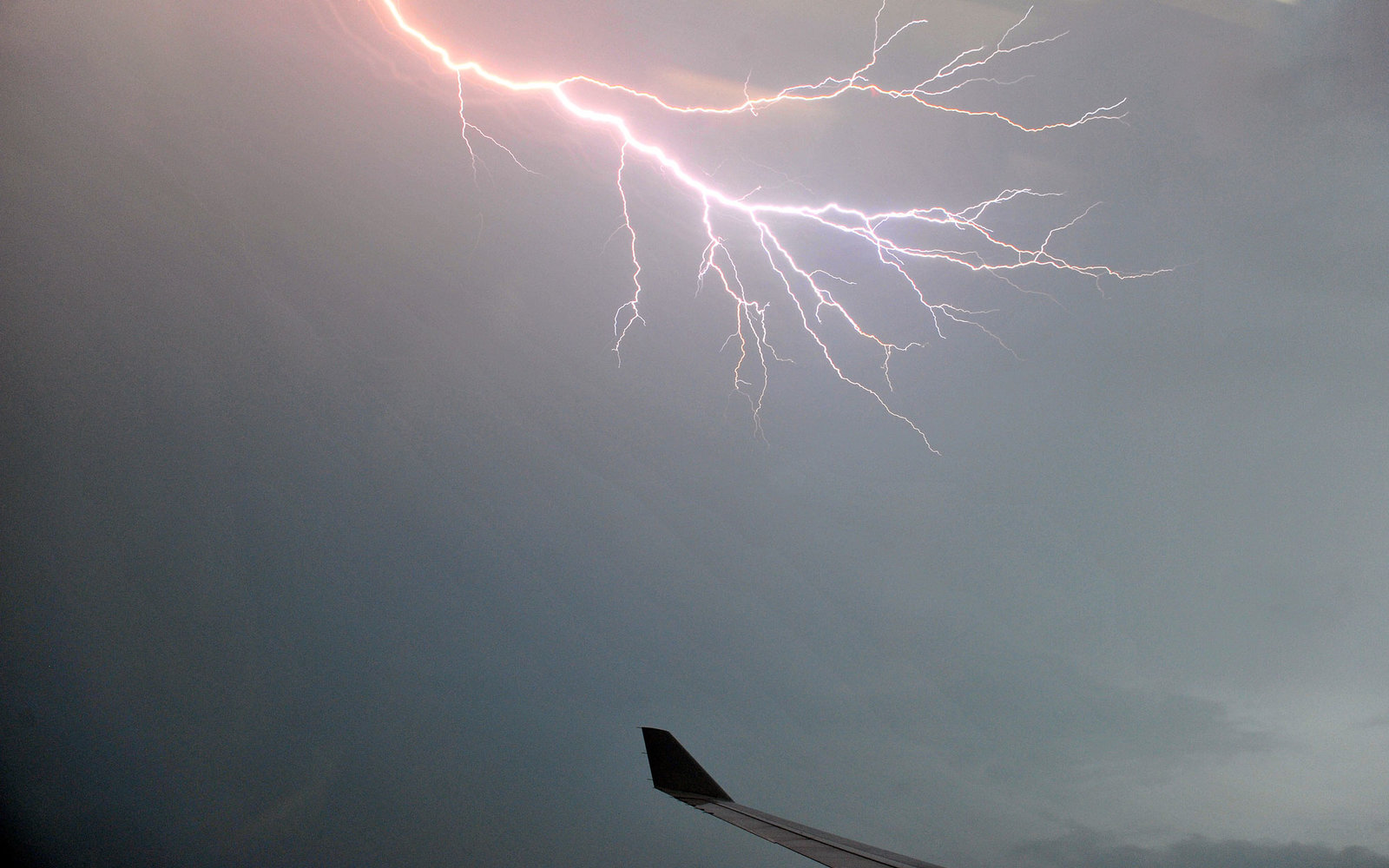 Lightning is seen from airplane