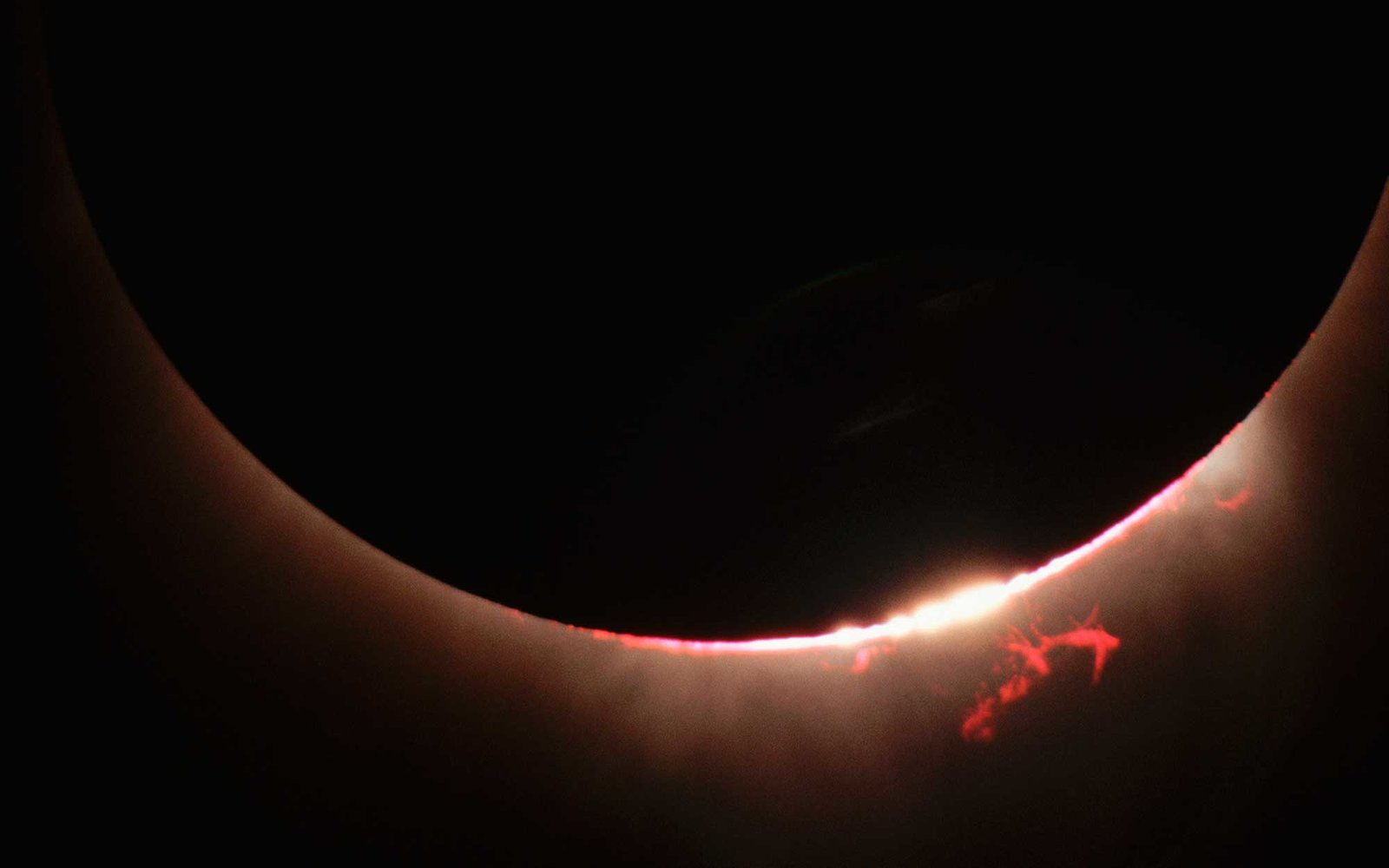 A close-up view of the Sun's disk during a total eclipse reveals fiery solar prominences. | View from: Mauna Kea Science Reserve.   (Photo by Roger Ressmeyer/Corbis/VCG via Getty Images)