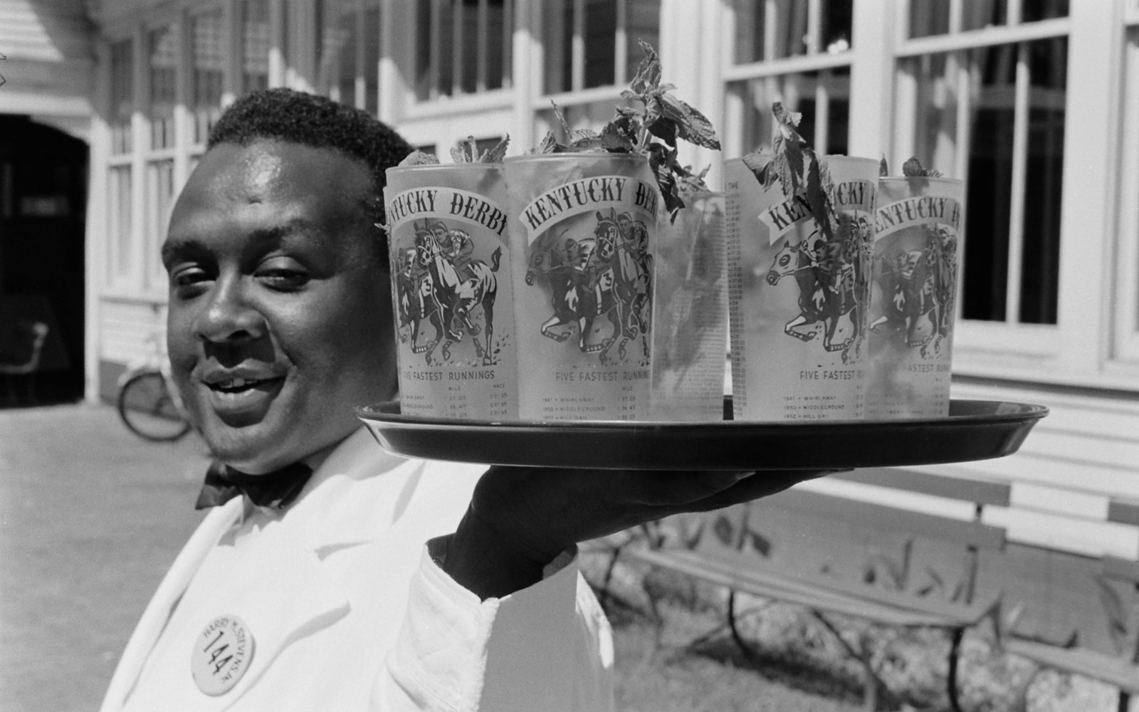 A waiter carrying mint juleps, 1955