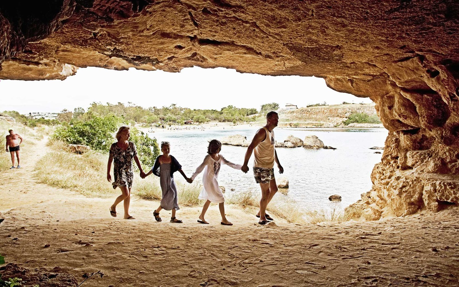 Family walk in a cave on Crete.
