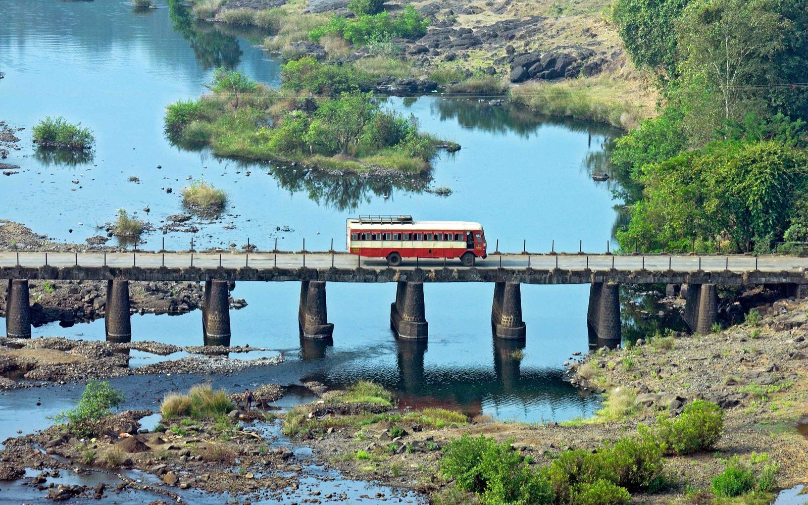 Bus crossing a bridge on chorna river, Bombay, Mumbai, Maharashtra, India