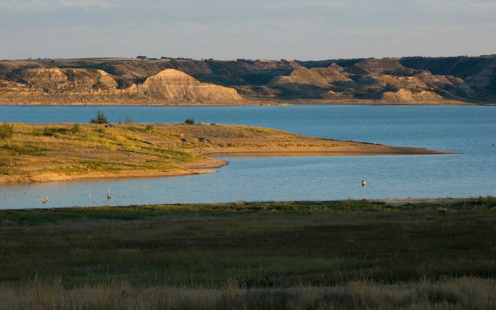 Missouri River, also known as Lake Sacajawea, with its high bluffs along the river banks flows through the homelands of the Mandan, Hidatsa and Arikara (Three Affiliated Tribes) on the Fort Berthold Indian Reservation