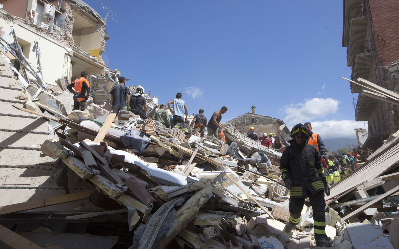 Firefighters clear rubble in Italy