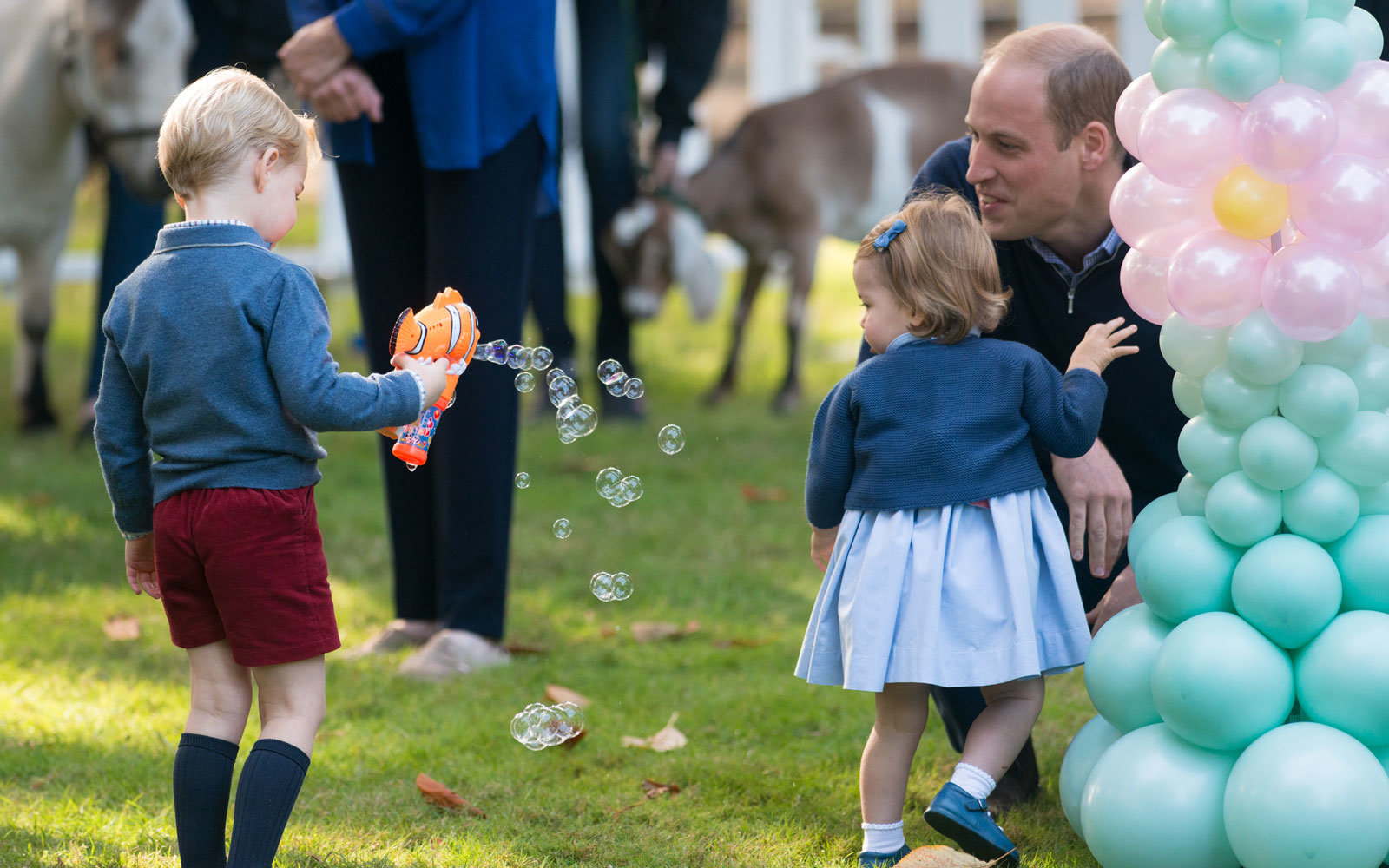 Prince George, Princess Charlotte and their father.