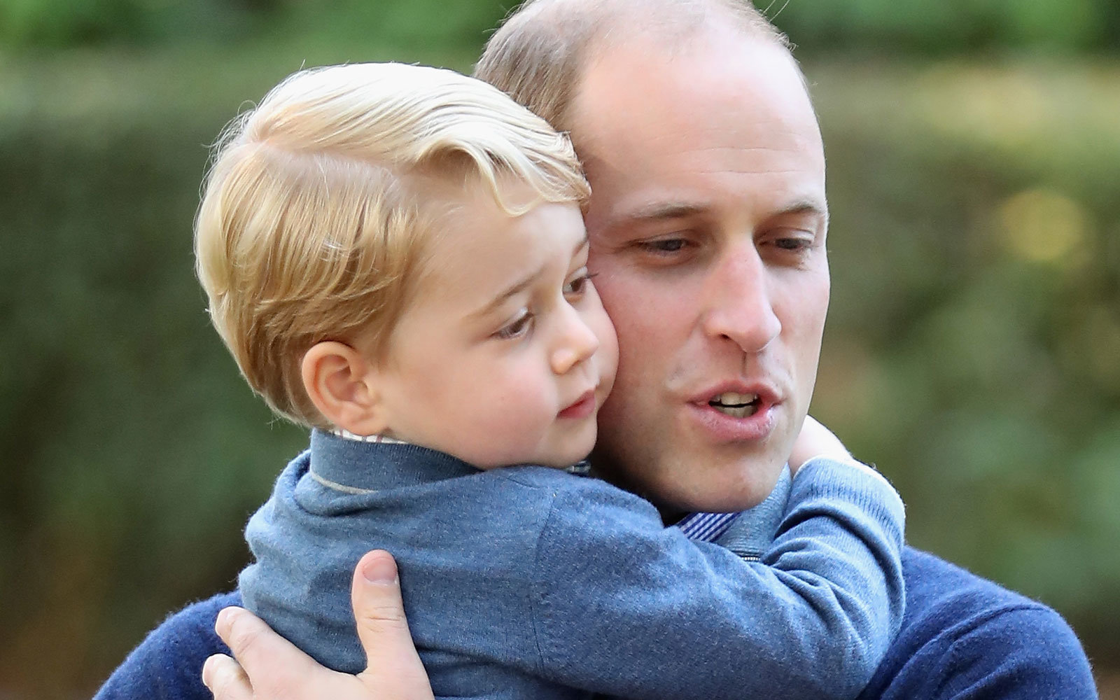 Prince George hugs his father.