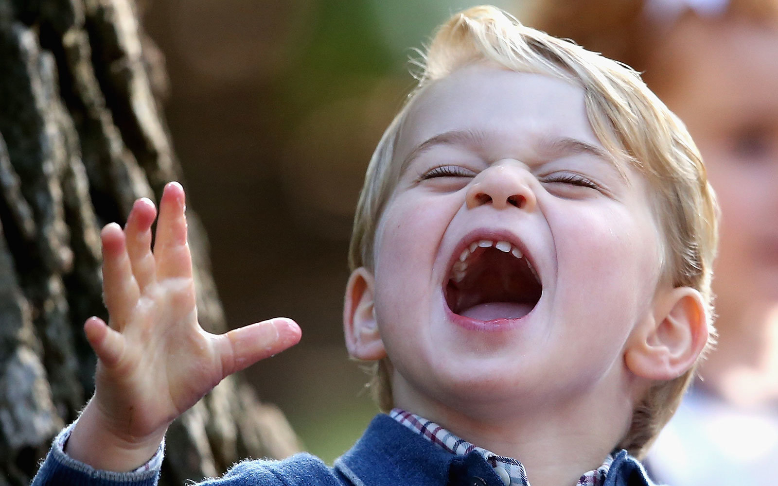 Prince George loves bubbles.