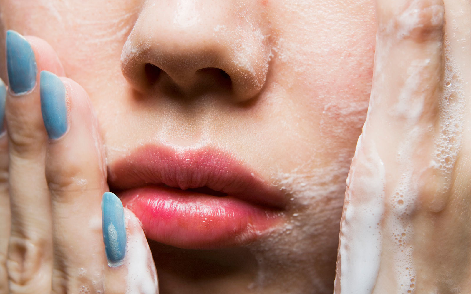 You're not washing your face well enough — and it could be hurting your skin