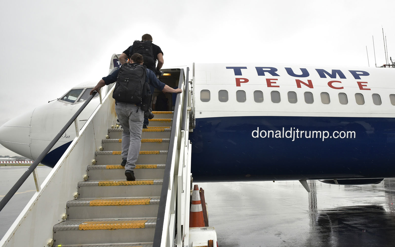 Journalists board the new Trump press plane for the first time at LaGuardia airport on Sept. 19, 2016 in New York.