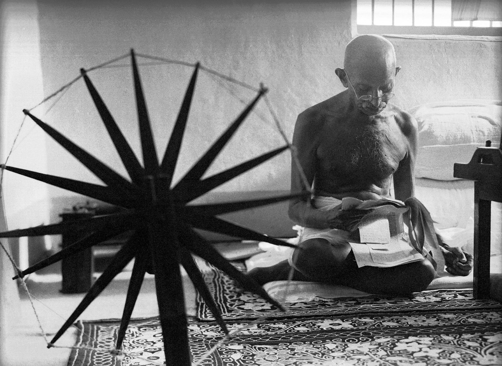 Gandhi and the spinning wheel.