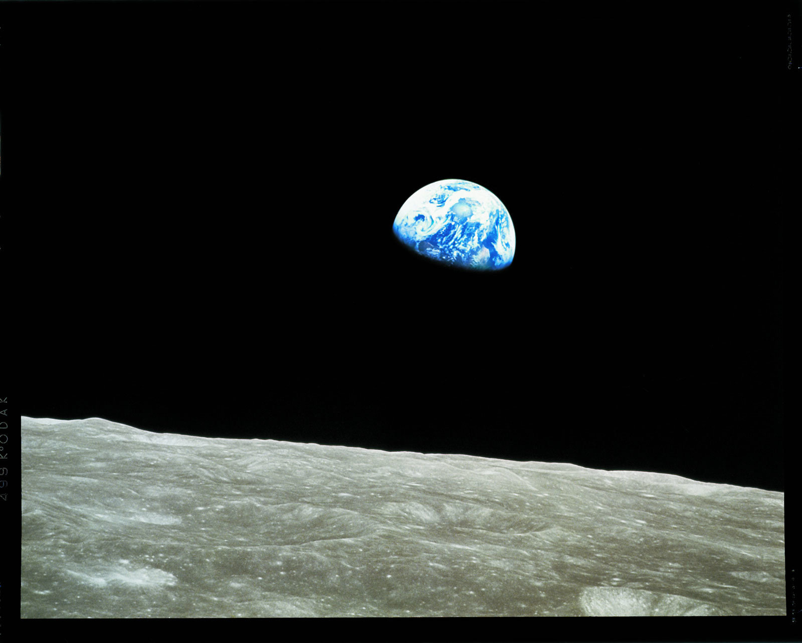 The Earth rises over the horizon of the moon.
