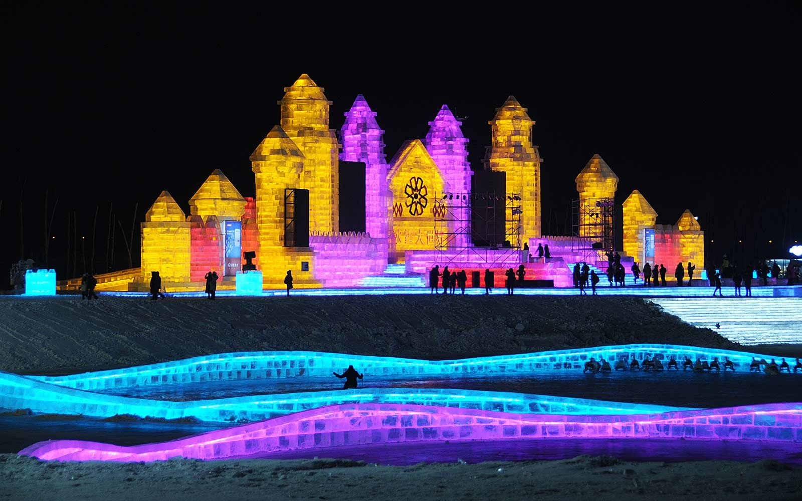 this ice festival in china is a dazzling multi colored dream