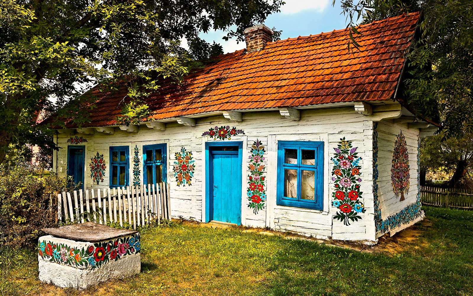 This polish village has been covered in flower paintings for House decoration images
