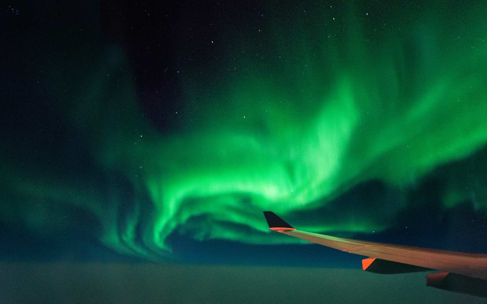 what the northern lights look like through an airplane