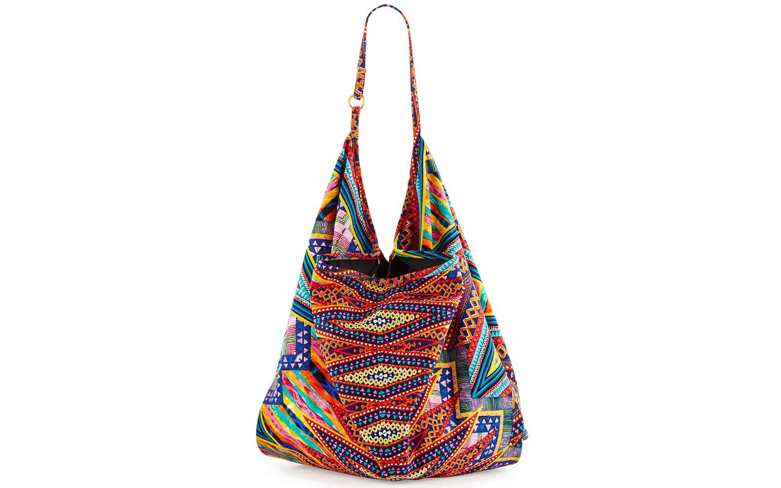 5daf91eed Stylish and Sturdy Beach Bags You Can Use As a Carry-on | Travel + ...