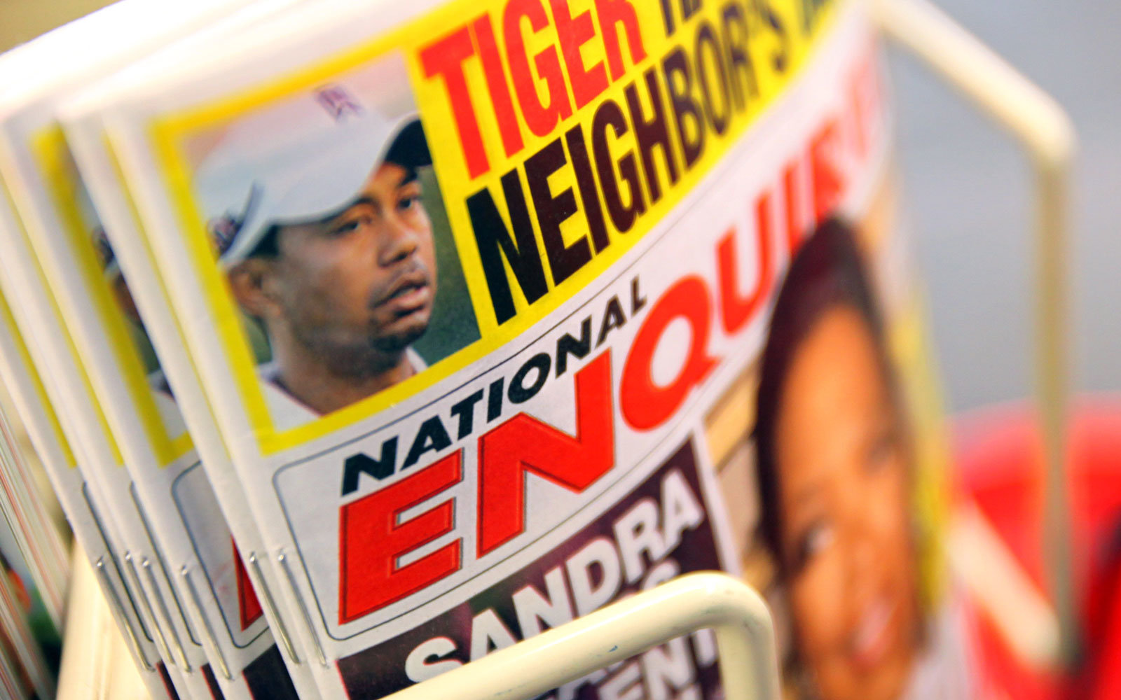 A National Enquirer cover at a newsstand.
