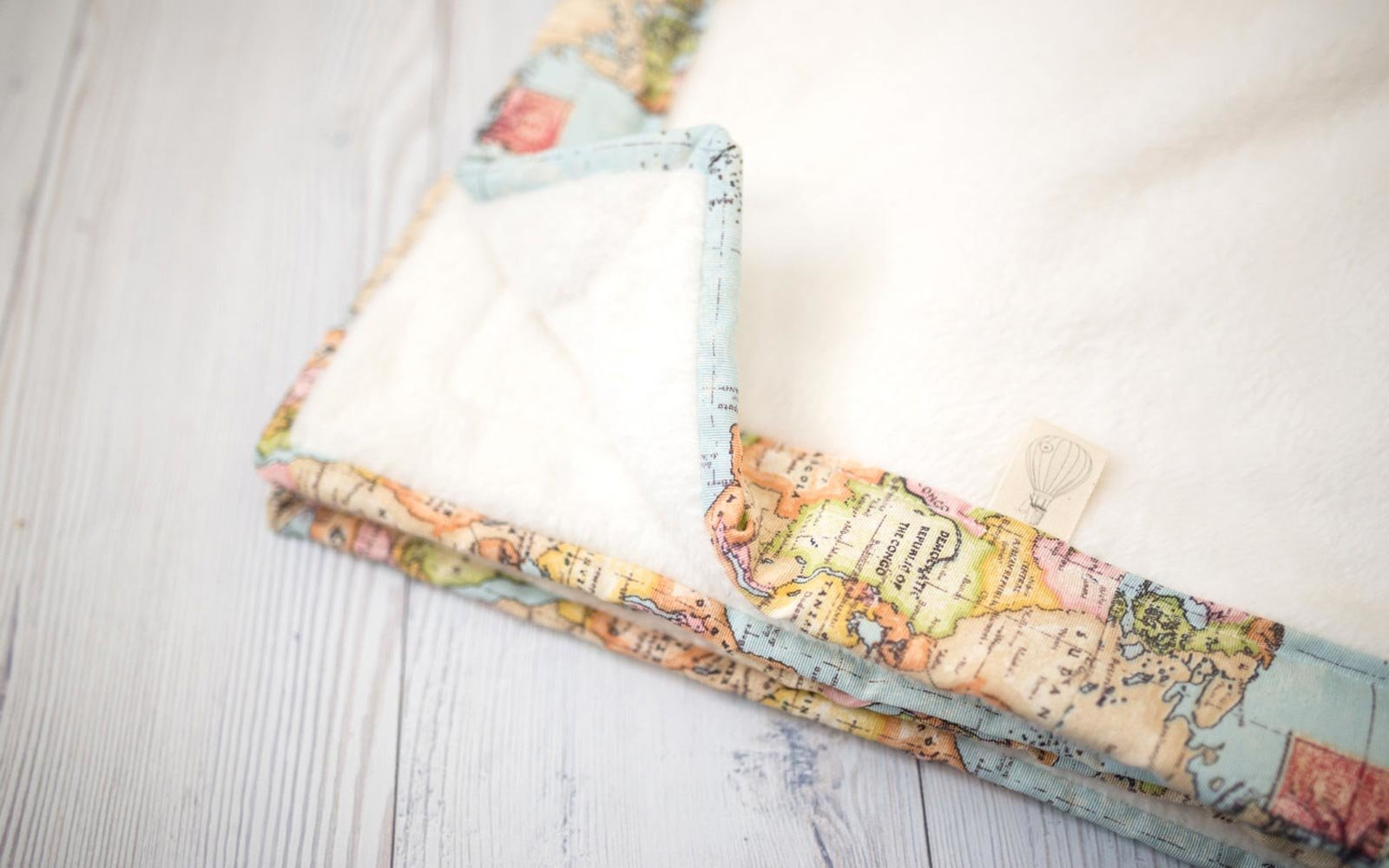 Travel themed nursery dcor and ideas travel leisure welcome to the world blanket gumiabroncs Choice Image