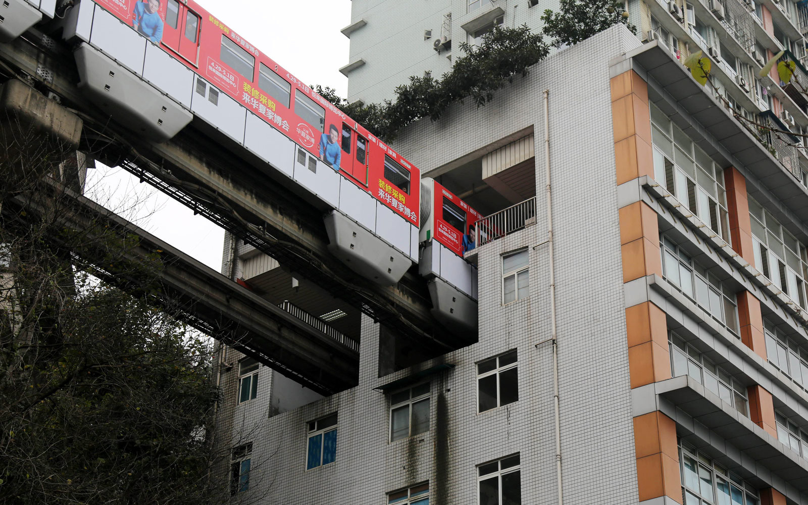 china-light-rail-passing-houses-RAIL317.jpg