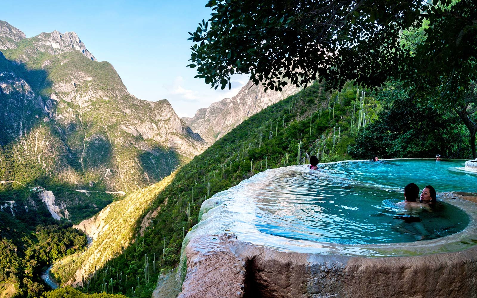 Relax in a Hot Spring Infinity Pool Overlooking Volcanic Mountains