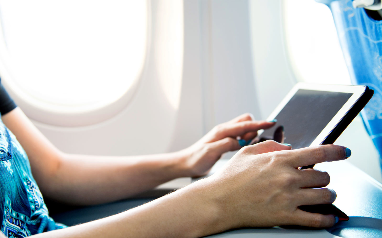 person-on-ipad-plane-IPAD317.jpg