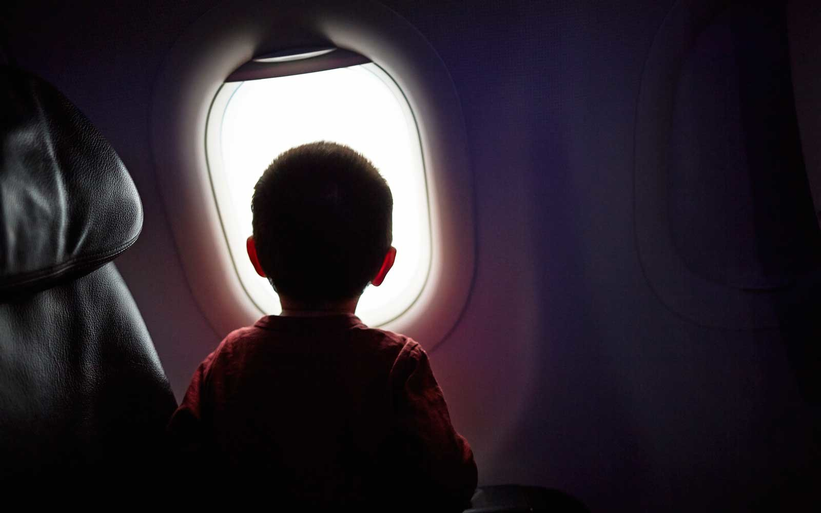 Secrets and Tips for Keeping Kids Happy on Long Flights