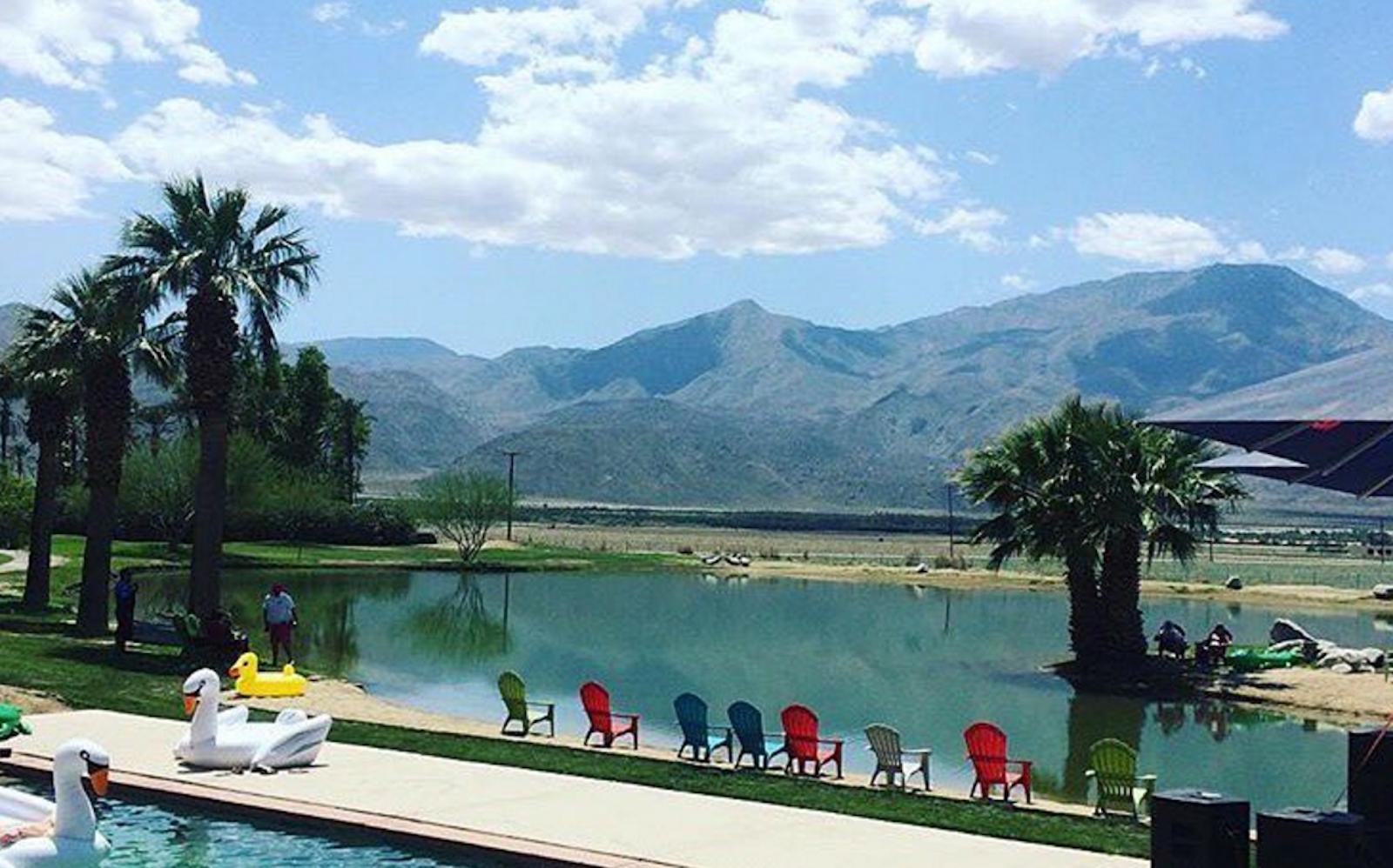 Lake and colorful chairs at Coachella Base Camp