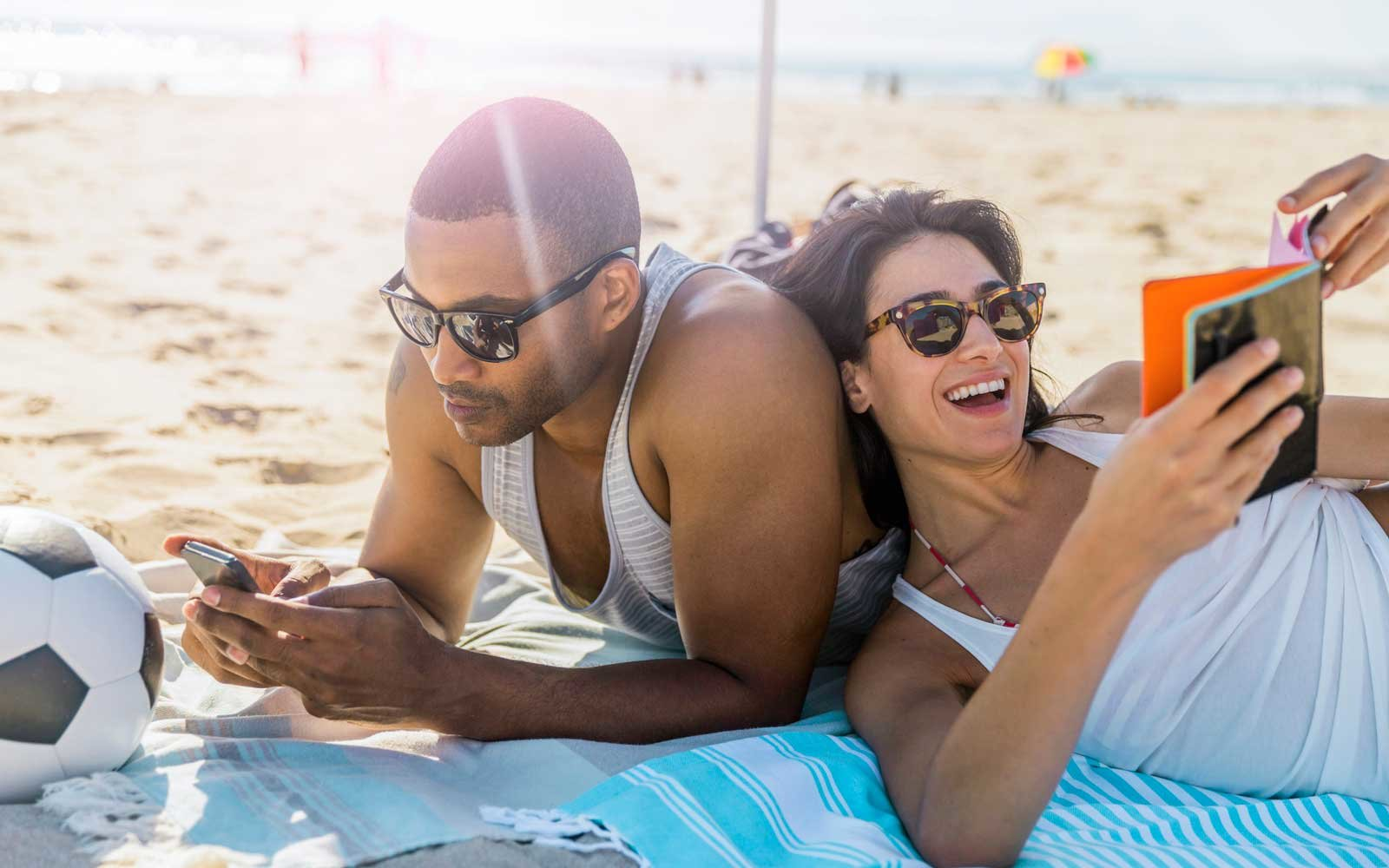 Couple Relaxing At Beach